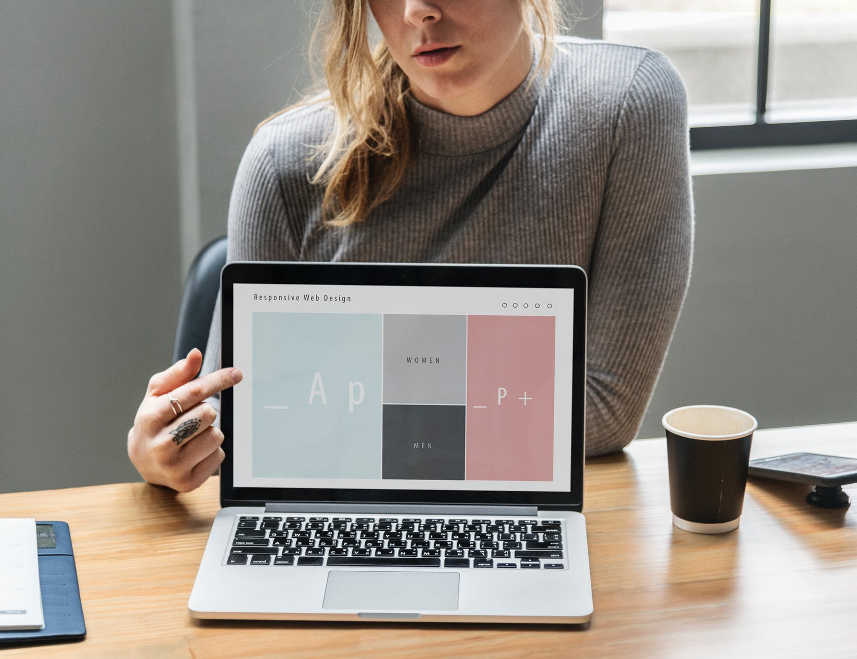woman pointing at laptop s screen
